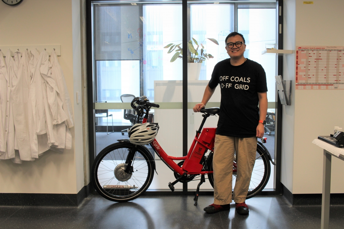 Alan Yu with a HERC hydrogen bicycle