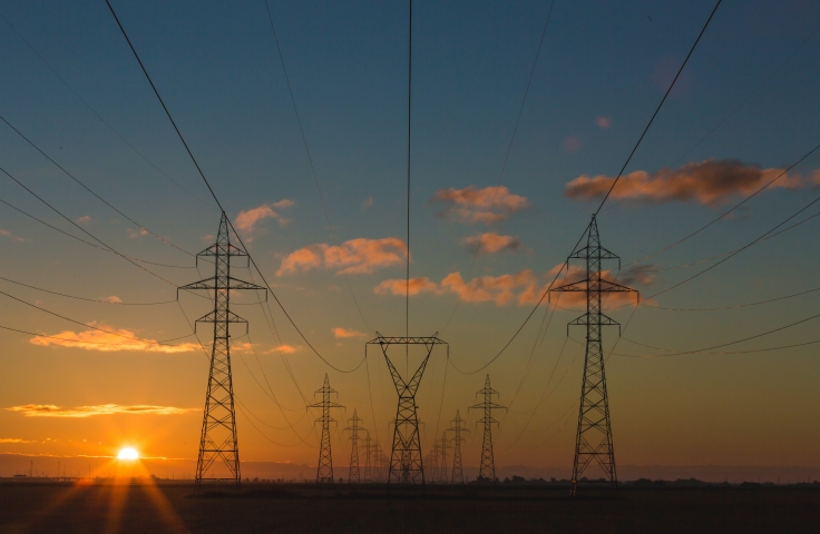 Power pylons at sunset - Photo by Matthew Henry on Unsplash